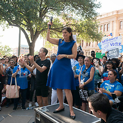 LUCI BAINES JOHNSON, daughter of former President Lyndon Johnson speaks to the crowd as a thousand Texas Democrats rally at the State Capitol supporting voting rights bills stalled in Congress and decrying Republican efforts to thwart voter registration and access to the polls.