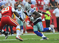 KANSAS CITY, MO - SEPTEMBER 15:  Wide receiver Dez Bryant #88 of the Dallas Cowboys rushes through defenders of the Kansas City Chiefs after catching a pass during the first half on September 15, 2013 at Arrowhead Stadium in Kansas City, Missouri.  Kansas City defeated Dallas 17-16. (Photo by Peter Aiken/Getty Images) *** Local Caption *** Dez Bryant