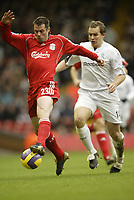 Photo: Aidan Ellis.<br /> Liverpool v Bolton Wanderers. The Barclays Premiership. 01/01/2007.<br /> Liverpool's Jamie Carragher Holds off Bolton's Kevin Davis
