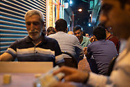 "Kurdish men drink tea and play games, including ""okey,"" a tile-based game similar to Rummikub, outside a teahouse in Diyarbakir, Turkey. (June 5, 2017)"