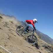 Alanna Columb from Queenstown in action during the New Zealand South Island Downhill Cup Mountain Bike series held on The Remarkables face with a stunning backdrop of the Wakatipu Basin. 150 riders took part in the two day event. Queenstown, Otago, New Zealand. 9th January 2012. Photo Tim Clayton