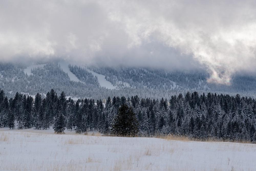 Rainbow cloud and Fergison Ridge Ski Area, Wallowa Mountains, Oregon.