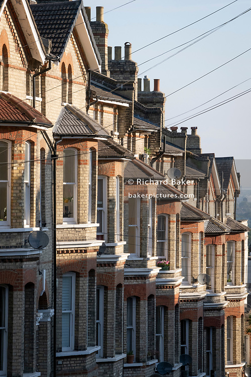 The bay windows of terraced homes at Crystal Palace, on 16th June 2021, in London, England.
