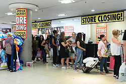 © Licensed to London News Pictures. 13/08/2016. Customers queue at the tills as British Homes Stores Oxford Street Flagship store closes on its last day of trading. London, UK. Photo credit: Ray Tang/LNP