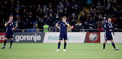 Scotland's David Bates (left), James Forrest (centre) and Callum McGregor (right) appear dejected after Kazakhstan's Baktiyar Zaynutdinov (not in picture) scores his side's third goal of the game during the UEFA Euro 2020 Qualifying, Group I match at the Astana Arena.