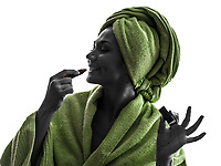 one woman applying lipstick in silhouette on white background