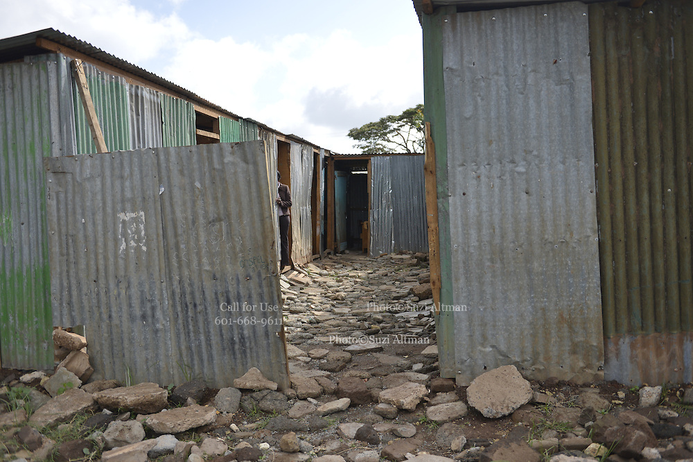 """Just outside downtown Nairobi, Kenya is the The Lenana Slum and the KevJumba school built by the NGO The Supply, images from a photography workshop in january 2014. Photo©SuziAltman In 2014, Suzi Altman traveled to Kenya at the invitation of The Supply, an NGO that operates a school in the Lenana slum, near Nairobi.<br />  <br /> While in residence at the Kevjumba School, Altman lead a photography class that taught self-identity and community identity utilizing photography as a tool, which helped children """"see"""" the world they live in, as well as its relation to the broader world outside their community. Together, photography and the written word were powerful instruments for the students to express themselves. The students took photographs of themselves and their community, highlighting positive aspects in each. Through the workshop, the students' voices became stronger, and they discovered commonalities with other cultures around the world, like the importance of family, shelter, education, and religion.<br />  <br /> While in the Lenana slum, Suzi photographed the children and places she encountered in the community. The subjects are workshop participants and other community members. What became most evident among those she visited were the tremendous sense of pride in their homes, communities, and schools, and the moments of happiness, which is evoked in the resulting series of photographs."""