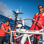 Leg 8 from Itajai to Newport, day 03 on board MAPFRE, going through a crude extraction area, Blair Tuke steering and Juan Vila at the aft pedestal. 24 April, 2018.