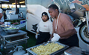 Rawhyde chefs prepare a meal for customers and guests.