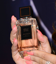 (Perfume bottle) <br /> Model Kelly Brook launches her new fragrance at The Perfume Shop on Oxford Street, London, UK. Monday, 17th March 2014. Picture by Nils Jorgensen / i-Images