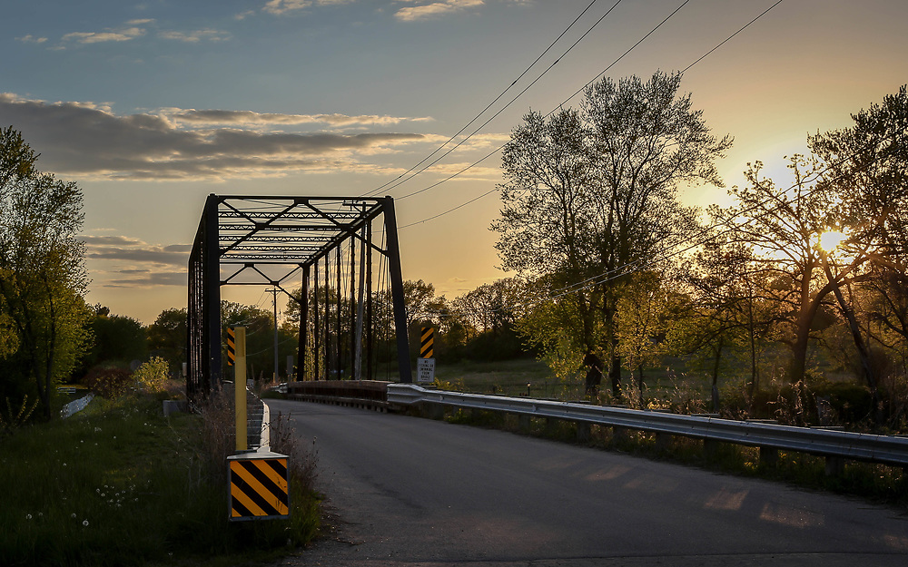 Wisconsin Rustic Road, Dane County, Dyreson Rustic Road Bridge, a truss bridge of steel built in 1897 over the Yahara River. Photo taken May 13, 2021, at sunset, eve of waxing crescent moon and Mercury conjunction.