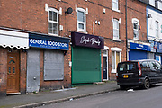 As the third national coronavirus lockdown continues, the streets remain very empty, and shops remain closed with shutters down, like these small businesses in Balsall Heath on 18th January 2021 in Birmingham, United Kingdom. Following the recent surge in cases including the new variant of Covid-19, this nationwide lockdown, which is an effective Tier Five, advises all citizens to follow the message to stay at home, protect the NHS and save lives.