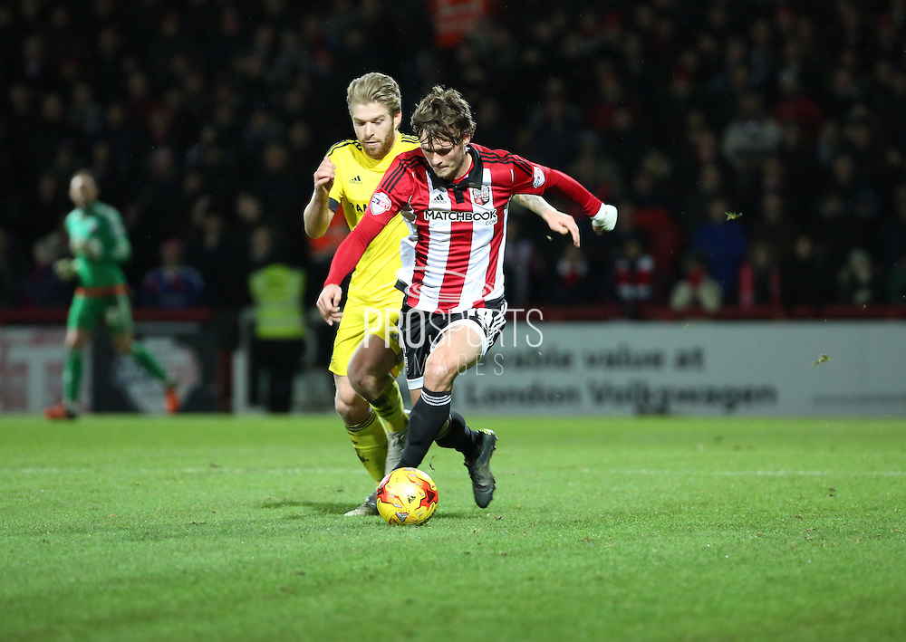 Brentford midfielder John Swift powering away in midfield during the Sky Bet Championship match between Brentford and Middlesbrough at Griffin Park, London, England on 12 January 2016. Photo by Matthew Redman.
