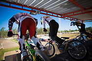 Riders burst out of the start gate during the practice round at the UCI BMX Supercross World Cup in Santiago del Estero, Argintina.