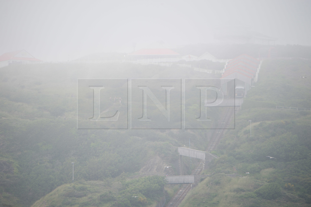 © Licensed to London News Pictures. 29/06/2019. Aberystwyth, UK. As the south east of England is experiencing record breaking hot weather, Aberystwyth on the west coast of Wales is shrouded in low cloud and sea mist, keeping the temperatures substantially cooler. Photo credit : Keith Morris/LNP