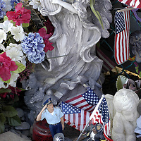 PIT2002091003 - Shanksville, Pa., Sept. 10 (UPI) -- An angel statue watches over the small figures of firemen and a police officer at the temporary memorial overlooking the crash site of Flight 93 near Shanksville, Pennsylvania on Sept. 10 2002.  awc/Archie Carpenter     UPI