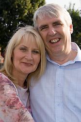 Mature couple; smiling,
