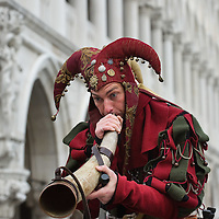 VENICE, ITALY - FEBRUARY 11: A man in costume blows a horn during the traditional parade for the Festa delle Marie in St Mark's Square on February 11, 2012 in Venice, Italy.The annual festival, which lasts nearly three weeks, will see the streets and canals of Venice filled with people wearing highly-decorative and imaginative carnival costumes and masks.