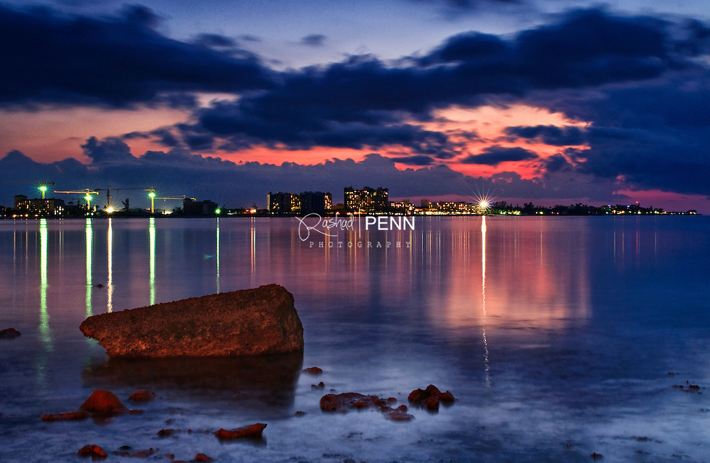 After sun has set the lights of life provide illumination on a calm day that was reflected in the sea.<br /> <br /> <br /> Fine Art Photography - The Bahamian Seascape