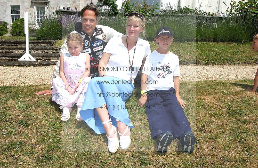 """The EARL & COUNTESS OF MARCH with two of their children LORD WILLIAM GORDON-LENNOX and LADY ELOISE GORDON-LENNOX at a luncheon hosted by Cartier at the 2005 Goodwood Festival of Speed on 26th June 2005.  Cartier sponsored the """"Style Et Luxe' for vintage cars on the final day of this annual event at Goodwood House, West Sussex. <br /><br />NON EXCLUSIVE - WORLD RIGHTS"""