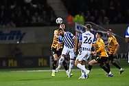 Cambridge United defender Lloyd Jones (6)  and Sheffield Wednesday forward Callum Paterson  (13)  battles for possession during the EFL Sky Bet League 1 match between Cambridge United and Sheffield Wednesday at the Abbey Stadium, Cambridge, England on 19 October 2021.