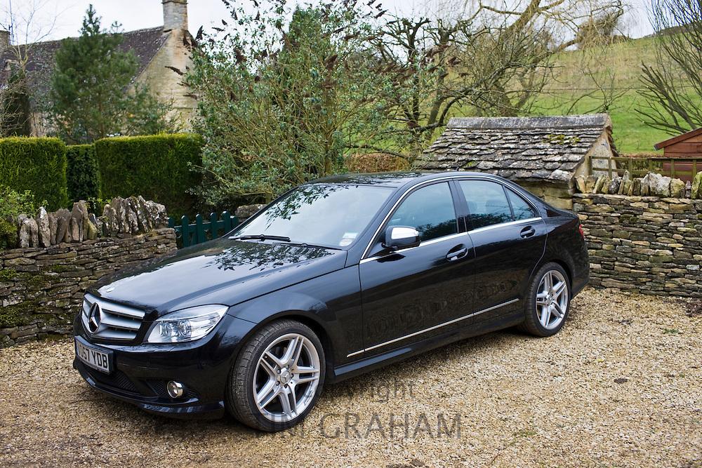 Black Mercedes C350 sport saloon car, Cotswolds, Oxfordshire, United Kingdom