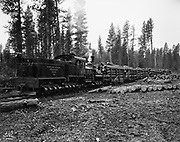 """9336-W63. Oregon & Northwestern logging train owned by the Edward Hines Lumber Company, Hines, Oregon. The engine is Baldwin #26, purchased new by Hines in 1929. Photo dates from 1930 - 1934. Photo by R. W. Heck. Soure: 8x10"""" negative. """"No. 63."""""""