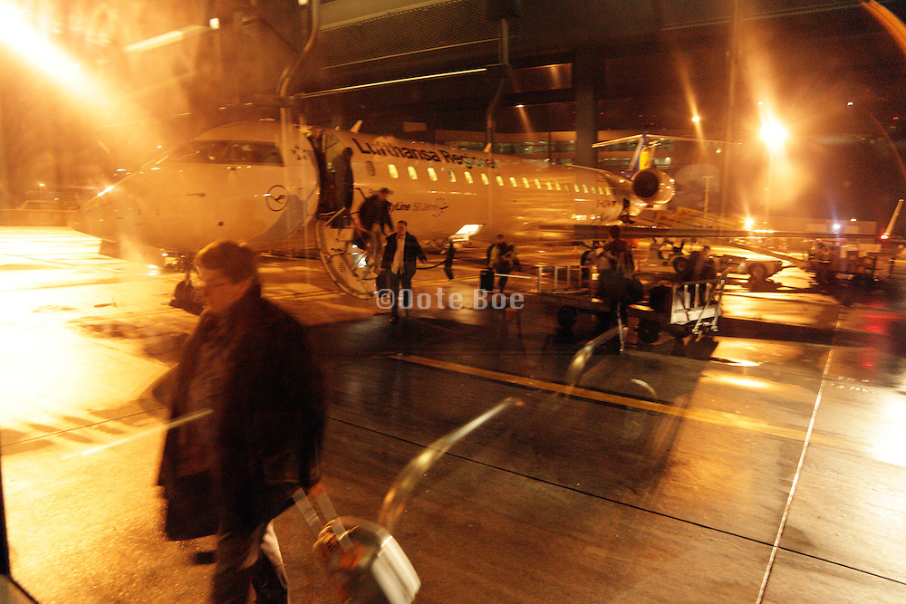 passengers disembarking from an airplane