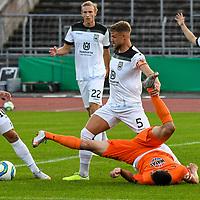 12.09.2020, Donaustadion, Ulm, GER, DFB Pokal, SSV Ulm 1846 Fussball vs FC Erzgebirge Aue, <br /> DFL REGULATIONS PROHIBIT ANY USE OF PHOTOGRAPHS AS IMAGE SEQUENCES AND/OR QUASI-VIDEO, <br /> im Bild Johannes Reichert (Ulm, #5) gewinnt den Kampf um den Ball gegen Ognjen Gnjatic (Aue, #33), Ardian Morina (Ulm, #10)<br /> <br /> Foto © nordphoto / Hafner