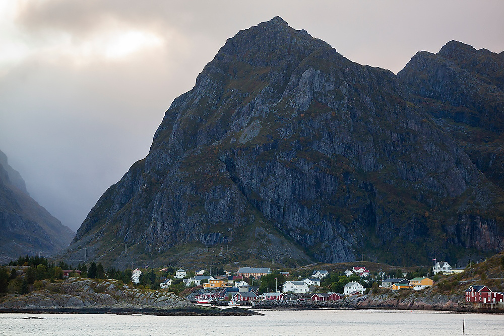 High mountains loom over the town of Moskenes, Lofoten Islands, Norway.