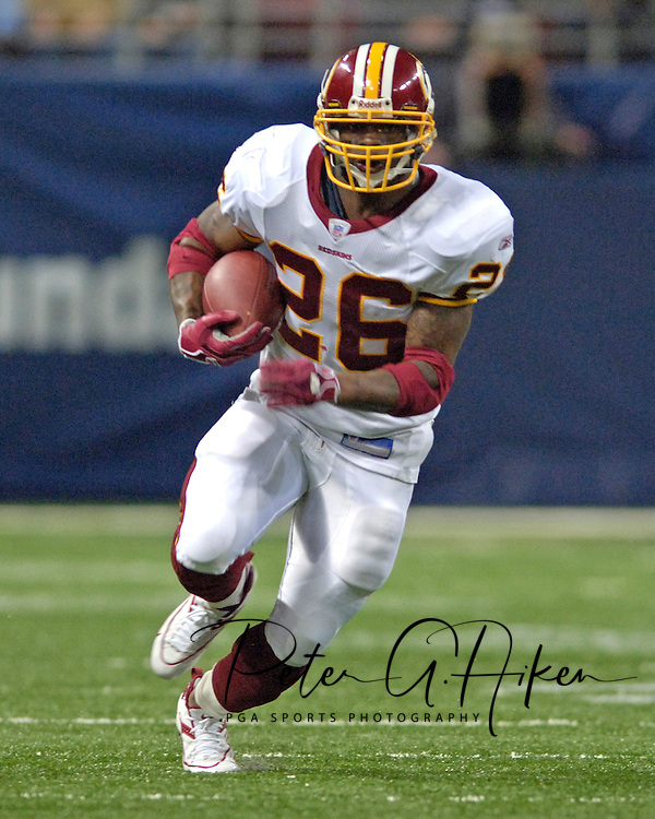Washington Redskins running back Clinton Portis rushes up field in the first half against the St. Louis Rams, at the Edward Jones Dome in St. Louis, Missouri, December 4, 2005.  The Redskins beat the Rams 24-9.