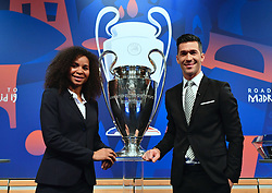 NYON, SWITZERLAND - Monday, December 17, 2018: Lyon player Laura Georges (L) and former Liverpool player and Champions League winner Luis Garcia pose next to the European Cup trophy after the UEFA Champions League 2018/19 Round of 16 draw at the UEFA House of European Football. (Handout by UEFA)