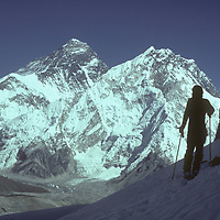 Mountaineer Dr. Peter Hackett skis on the Changri Nup Glacier near Mount Everest, which towers in the background.