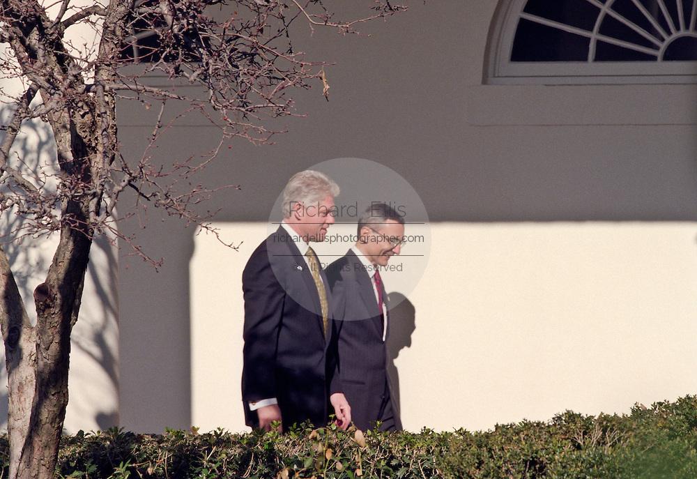 President Bill Clinton walks with adviser John Podesta at  the White House January 26, 1999.