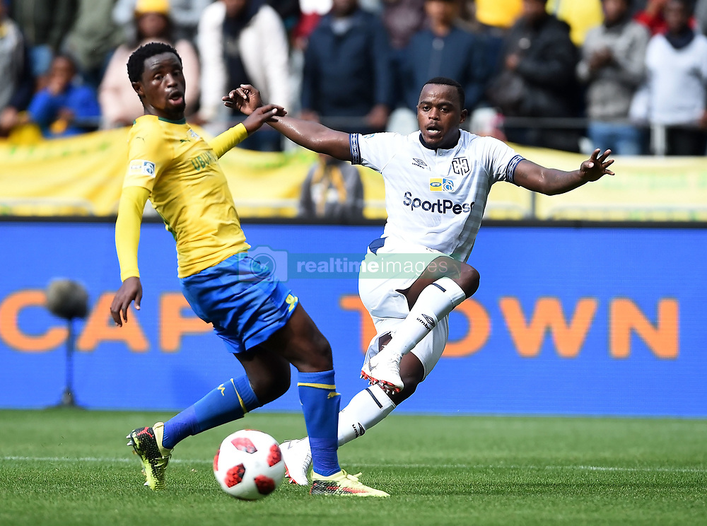 Cape Town-180825- Cape Town City player Ayanda Patosi challenged by Mamelodi Sundowns midfielder Lucky Mohomi  in the MTN 8 semi-final at Cape Town Stadum.Photographer :Phando Jikelo/African News Agency/ANA