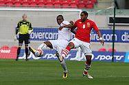 Ashley Williams of Wales battles for the ball with Joel Kitenge of Luxembourg.  friendly international match, Wales v Luxembourg at the Parc y Scarlets stadium in  Llanelli on Wed 11th August 2010. pic by Andrew Orchard, Andrew Orchard sports photography,