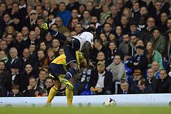 Sunderland's midfielder Liam Bridcutt and Tottenham's forward Emmanuel Adebayor compete for the ball  - Photo mandatory by-line: Mitchell Gunn/JMP - Tel: Mobile: 07966 386802 07/04/2014 - SPORT - FOOTBALL - White Hart Lane - London - Tottenham Hotspur v Sunderland - Premier League