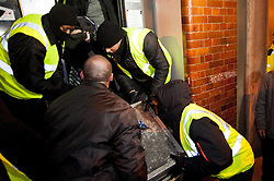 © licensed to London News Pictures. London, UK. 30/01/12. Bailiffs remove iterms from the Earl Street squat Bailiffs & police move to evict the 'Bank of Ideas' squatted UBS property on sun street and adjacent squat on Earl Street, EC2 after UBS obtained a possession order for the property. Photo credit: Jules Mattsson/LNP