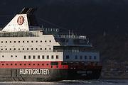 MS Richard With sailing into Herøyfjord, Norway | Hurtigruteskipet MS Richard With seiler inn i Herøyfjord, Norge. Moltustranda i bakgrunnen.