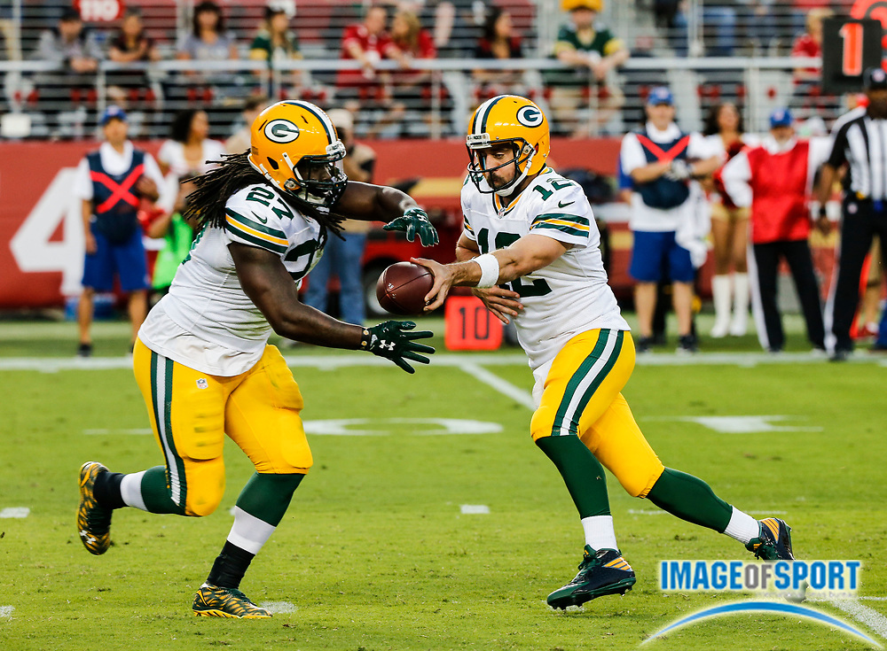 Aug 26, 2016, Santa Clara, CA, USA; Green Bay Packers quarterback Aaron Rodgers (12) hands off to running back Eddie Lacy (27) against the San Francisco 49ers in a preseason NFL game at Levi's Stadium. Green Bay beat San Francisco 21-10.