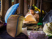 10 NOVEMBER 2014 - SITTWE, MYANMAR: A woman sifts rice in the rice market in Sittwe, Myanmar. Sittwe is a small town in the Myanmar state of Rakhine, on the Bay of Bengal.    PHOTO BY JACK KURTZ