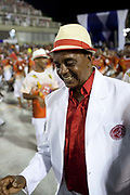Older male dancers dressed in white, dancing for Salgueiro Samba School doing the final practice performance of their Carnival procession in the Sambadrome, Rio de Janeiro, Brazil