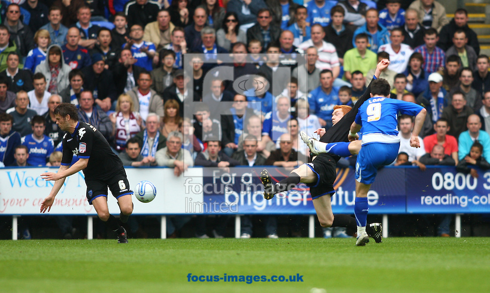 Shane Long (9) of Reading scores their first goal during the Npower Championship match between Reading and Portsmouth at the Madejski Stadium on Saturday 2nd April 2011. (Photo by Andrew Tobin/Focus Images)