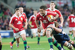 © Licensed to London News Pictures. 25/6/2013. Toby Faletau gets tackeld during the British & irish Lions tour match between Melbourne Rebels Vs British & Irish Lions at AAMI Park, Melbourne, Australia. Photo credit : Asanka Brendon Ratnayake/LNP