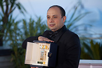 Cesar Diaz, winner of the Camera d'Or award for the film Nuestras Madres at the Palme D'Or Award photo call at the 72nd Cannes Film Festival, Saturday 25th May 2019, Cannes, France. Photo credit: Doreen Kennedy