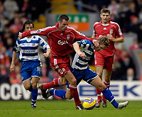 Photo: Jed Wee.<br />Liverpool v Reading. The Barclays Premiership. 04/11/2006.<br /><br />Liverpool's Jamie Carragher (L) makes his presence felt on Reading's Kevin Doyle.