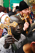 Israel, Jerusalem The Via Dolorosa Procession, Good Friday, Easter 2007. African pilgrim holding a crucifix