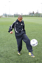 Boy in football practice on the playing field at his local leisure centre,