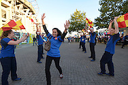 French Supporters run past 'The Pack'  outside Twickenham before k/o. Rugby World Cup 2015 pool D match, France v Italy at Twickenham Stadium in London on Saturday 19th September 2015.<br /> pic by John Patrick Fletcher, Andrew Orchard sports photography.