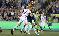 September 27, 2017 - Seattle, WASHINGTON, U.S - CLINT DEMPSEY (2) and TIM PARKER (26) in the air for a ball in a game between the Vancouver Whitecaps the Seattle Sounders for an MLS match at Century Link Field in Seattle, WA. (Credit Image: © Jeff Halstead via ZUMA Wire)